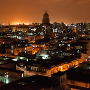 Night scene of Havana Cuba. The dominant building, center is the darkened dome of the Capitolio building in downtown Havana. Photo by Jen Klewitz