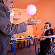 Khalid attends one on one instruction in the Mercy Corps resource room. His volunteer instructor, Ibrahim (also a refugee), has over 35 years of teaching experience in Syria. Zaatari camp for Syrian refugees, Jordan, April 2015.