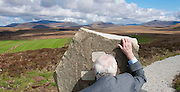 Minister John Gormley T.D., looks through a viewing stone across the plains of  the Ballycroy National Park. Pic: Michael Mc Laughlin