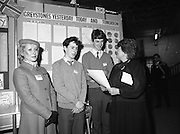 11/01/1985.01/11/1985.11th January 1985.The Aer Lingus Young Scientist Exhibition at the RDS Dublin...Gemma Hussey, T.D. (right) Minister for Education chatting with Daragh O'Toole (second from left) and Fin Kelleher (third from left) both of St. David's Secondary School, Greystones, Co. Wicklow at their stand showing the 'Development of Greystones' with Aer Lingus Hostess Sally Ann Flanagan. ..