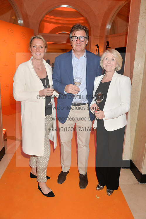Left to right, ANNOUSHKA DUCAS, JOHN AYTON and GILLY MACKWOOD at the Veuve Clicquot Business Woman Awards held at Claridge's, Brook Street, London on 11th May 2015.