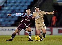 Photo: Jed Wee.<br /> Scunthorpe United v Bristol City. Coca Cola League 1. 14/02/2006.<br /> <br /> Bristol's Scott Brown (R) tussles with Scunthorpe's Michael Rose.