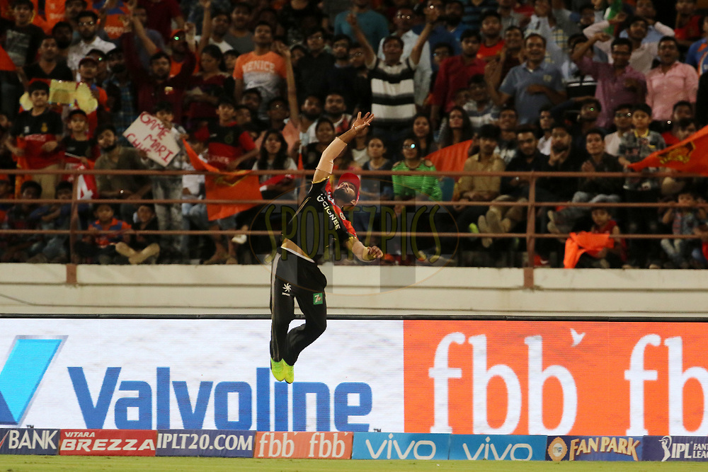 Mandeep Singh of the Royal Challengers Bangalore jumps to take the catch of Aaron Finch of the Gujarat Lions during match 20 of the Vivo 2017 Indian Premier League between the Gujarat Lions and the Royal Challengers Bangalore  held at the Saurashtra Cricket Association Stadium in Rajkot, India on the 18th April 2017<br /> <br /> Photo by Vipin Pawar - Sportzpics - IPL