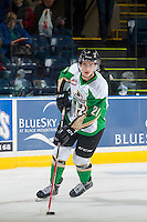 KELOWNA, CANADA - DECEMBER 6: Matteo Gennaro #21 of Prince Albert Raiders skates with the puck during warm up against the Kelowna Rockets on December 6, 2014 at Prospera Place in Kelowna, British Columbia, Canada.  (Photo by Marissa Baecker/Shoot the Breeze)  *** Local Caption *** Matteo Gennaro;