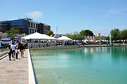 People on the Walkway Bisecting Peace Lake at Soka University During the 18th annual International Festival
