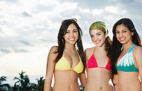 Three teenage girls (16-17) wearing bikinis portrait