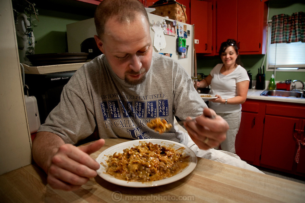 Coalminer Todd Kincer and his wife sharing a meal of Hamburger Helper at home near Whitesburg, Kentucky. (Todd Kincer is featured in the book What I Eat: Around the World in 80 Diets.)