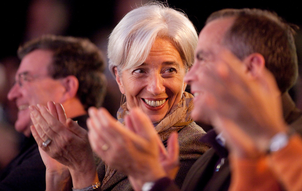 France's Minister of the Economy, Industry and Employment, Christine Lagarde, left, applauds with Bank of Canada Governor Mark Carney during a Inuit performance at the G7 Finance Ministers meeting in Iqaluit, Canada, February 5, 2010.<br /> AFP/GEOFF ROBINS/STR
