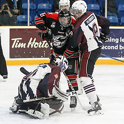 "TRENTON, ON  - MAY 2,  2017: Canadian Junior Hockey League, Central Canadian Jr. ""A"" Championship. The Dudley Hewitt Cup. Game 1 between Dryden GM Ice Dogs and the Georgetown Raiders. Andrew Court #88 of the Georgetown Raiders and  Lucas Robinson #8 of the Dryden GM Ice Dogs  battle for position in the crease during the first period.<br /> (Photo by Tim Bates / OJHL Images)"