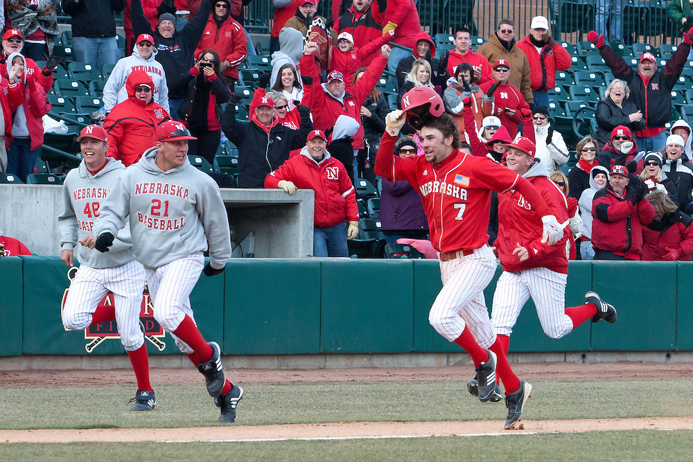 06 March 2011: Bryan Peters #7 of the Nebraska Cornhuskers hits a homerun in the eleventh inning to defeating UCLA in the third game of the series 5 to 4 at Haymarket Park in Lincoln, Nebraska.