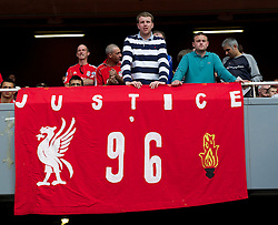 LONDON, ENGLAND - Sunday, April 17, 2011: Liverpool's supporters display a banner calling for Justice for the 96 victims of the Hillsborough Stadium Disaster during the Premiership match against Arsenal at the Emirates Stadium. (Photo by David Rawcliffe/Propaganda)