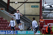 Millwall FC midfielder Ben Thompson (24)  heads the ball clear during the Sky Bet League 1 match between Bradford City and Millwall at the Coral Windows Stadium, Bradford, England on 26 March 2016. Photo by Simon Davies.