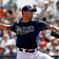 March 21, 2012; Port Charlotte, FL, USA; Tampa Bay Rays relief pitcher Kyle Farnsworth (43) throws against the New York Yankees during the top of the first inning of a spring training game at Charlotte Sports Park.  Mandatory Credit: Derick E. Hingle-US PRESSWIRE