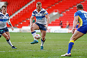 Featherstone Rovers interchange Keal Carlile (9) kicks through during the Challenge Cup 2018 match between Doncaster and Featherstone Rovers at the Keepmoat Stadium, Doncaster, England on 22 April 2018. Picture by Simon Davies.