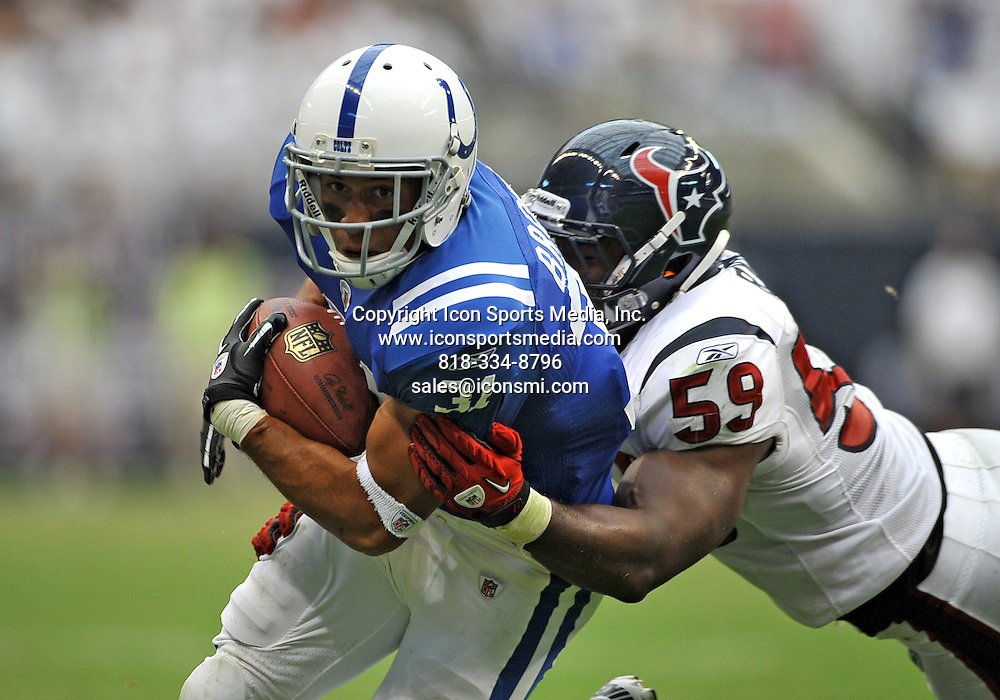 12 September 2010: Indianapolis Colts running back Donald Brown #31 and Houston Texans linebacker DeMeco Ryans #59 during the game between the Indianapolis Colts and the Houston Texans at Reliant Stadium in Houston, Texas. Texans win against the Colts 34-24.