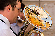 A baritone player marches through the cobblestone streets of Cagli, Italy, during a procession held in celebration of Corpus Christi, on June 14, 2009. Corpus Christi is held to commemorate the institution of the Holy Eucharist.