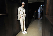 A model waits before the Thom Browne Fall 2015 collection is shown during New York Fashion Week, Monday, Feb. 16, 2015.  (AP Photo/Diane Bondareff)