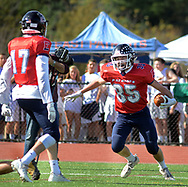 Central Bucks East's Pat Volko (35) and Logan Pettigrew (17) celebrate a touchdown against Central Bucks West in the first quarter Saturday, October 21, 2017 at Central Bucks East in Buckingham, Pennsylvania. (Photo by William Thomas Cain)