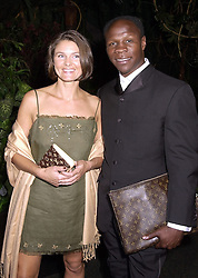 Boxer CHRIS EUBANK and his wife KARRON, at a gala evening in London on 14th September 2000.OGX 70