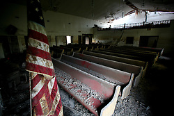 29 August 2007. Lower 9th Ward, New Orleans, Louisiana. <br /> Second anniversary of Hurricane Katrina. A deserted, empty church remain derelict and decimated in the Lower 9th Ward. The area remains mostly abandoned and overgrown, ghostly reminders of lives that once were. President Bush came to town and claimed he could be proud of what local and federal government have achieved in the city. Yet two years after the storm, it is quite clear that local and federal government are failing and have a great deal to do to live up their promises.<br /> Photo credit©; Charlie Varley/varleypix.com