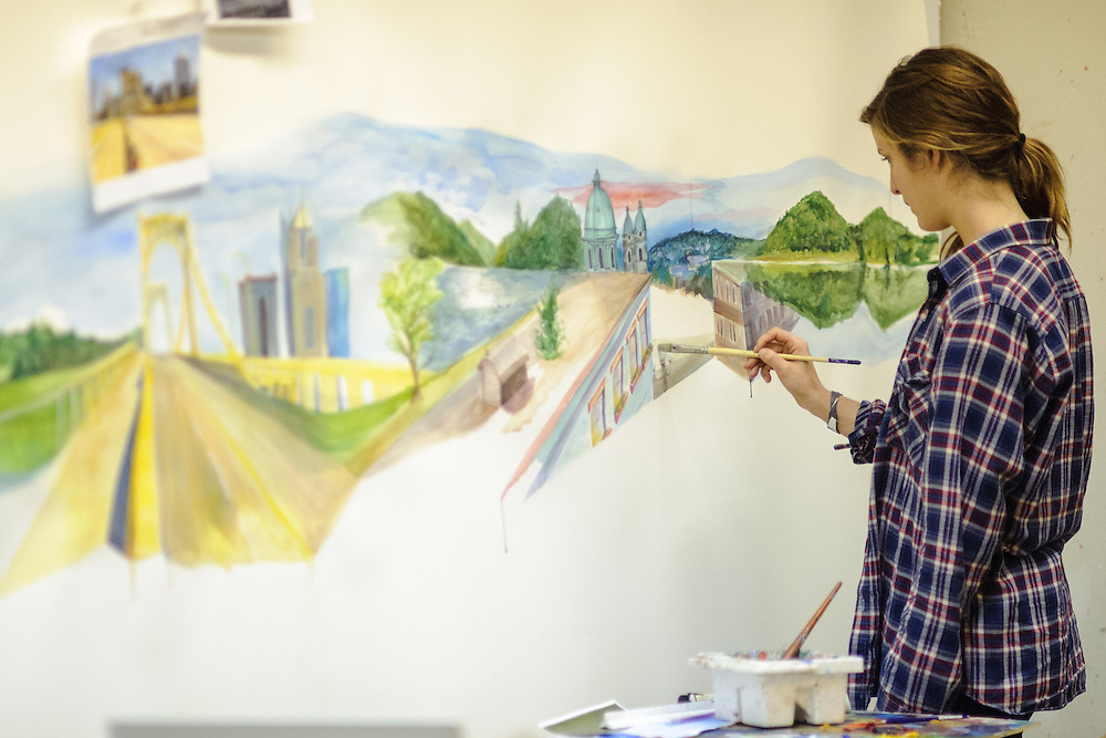 Ohio University student Anna Moore works on a painting in Seigfred Hall on Sunday, December 2, 2012.  (© Brien Vincent)