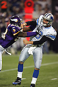 MINNEAPOLIS - NOVEMBER 21:  Linebacker E.J. Henderson #56 of the Minnesota Vikings puts a rush on quarterback Joey Harrington #3 of the Detroit Lions at the Hubert H. Humphrey Metrodome on November 21, 2004 in Minneapolis, Minnesota. The Vikings defeated the Lions 22-19. ©Paul Anthony Spinelli  *** Local Caption *** E.J. Henderson;Joey Harrington