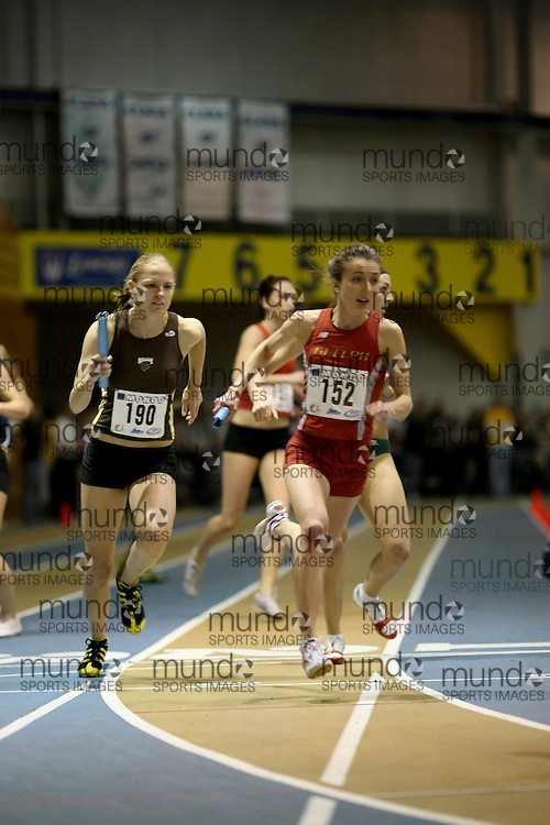 Windsor, Ontario ---14/03/09--- \cisJennifer Campbell of  the University of Manitoba (190) and Lindsay Carson of  the University of Guelph (152)\ competes in the Women's 4x400m Relay at the CIS track and field championships in Windsor, Ontario, March 14, 2009..Sean Burges Mundo Sport Images