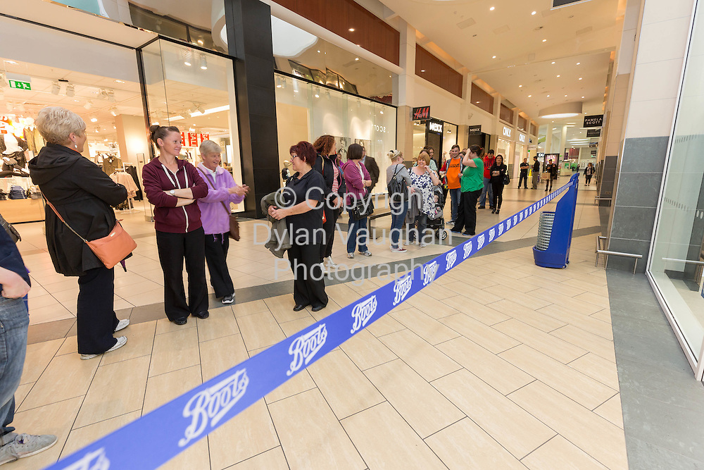 Repro free No Charge for Repro<br /> 1-10-14<br /> <br />  <br /> Pictured at the official opening of the new Boots store at Mac Donagh Junction Shopping Centre in Kilkenny on the 1st of October were queuing customers.<br /> <br /> <br /> <br /> <br /> Picture Dylan Vaughan
