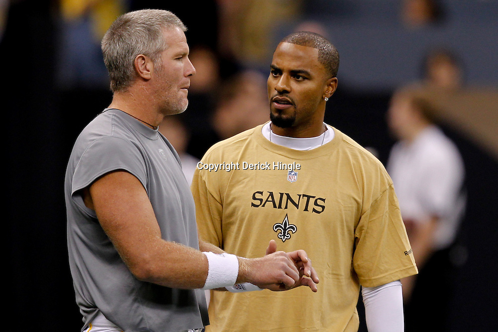 September 9, 2010; New Orleans, LA, USA; Minnesota Vikings quarterback Brett Favre talks to New Orleans Saints safety Darren Sharper during warm ups prior to the NFL Kickoff season opener between the Minnesota Vikings and the New Orleans Saints at the Louisiana Superdome. Mandatory Credit: Derick E. Hingle