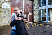 The moment a family is reunited with their dad after 2 and a half years of him inside HMP/YOI Portland, Dorset. © Prisonimage.org All image use must be agreed first. All images must be credited.