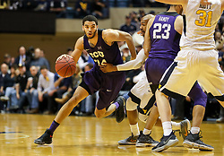 Feb 12, 2018; Morgantown, WV, USA; TCU Horned Frogs guard Kenrich Williams (34) dribbles during the first half against the West Virginia Mountaineers at WVU Coliseum. Mandatory Credit: Ben Queen-USA TODAY Sports