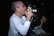 Nobuyoshi Araki . Party given for Nobuyoshi Araki by White Cube after the opening of his Self«Life«Death exhibition at the Barbican. Zyrus/Genesys Karaoke bar. Clerkenwell Rd. London. 5 October 2005. . ONE TIME USE ONLY - DO NOT ARCHIVE © Copyright Photograph by Dafydd Jones 66 Stockwell Park Rd. London SW9 0DA Tel 020 7733 0108 www.dafjones.com