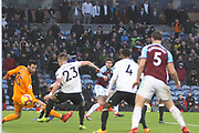 13 Jeff Hendrick for Burnley FC squeezes his shot past Fulham goalkeeper Sergio Rico (25) during the Premier League match between Burnley and Fulham at Turf Moor, Burnley, England on 12 January 2019.
