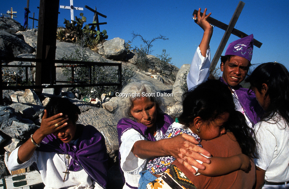 Curanderos, or healers, perform a healing ritual in Espinazo, Mexico at a bi-annual gathering of the followers of Nino Fidencio, a famous Mexican healer from the 1930's. Followers of Nino Fidencio believe that some healers become possessed by the spirit of Nino Fidencio and then have his healing powers. Thousands of believers make the pilgrimage each year to pray for miracles or to be healed. His believers, an estimated 20,000, gather in his hometown for a three-day festival twice a year in March and October. (Photo/Scott Dalton)