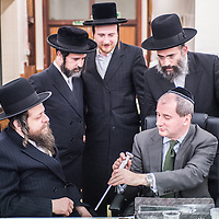 London, UK - 3 December 2014: Mr Stephen Williams MP, Parliamentary Under Secretary of State for Communities and Local Government, talks to members of the community as he visits Talmud-Torah Yetev-Lev orthodox Jewish school in Hackney, London