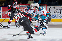 KELOWNA, CANADA -FEBRUARY 25: Troy Bourke #20 of the Prince George Cougars takes a shot against the Kelowna Rockets on February 25, 2014 at Prospera Place in Kelowna, British Columbia, Canada.   (Photo by Marissa Baecker/Getty Images)  *** Local Caption *** Troy Bourke;
