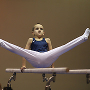 A young gymnasts in action on the parallel bars during the 21st American Invitational 2014 competition at the XL Centre. Hartford, Connecticut, USA. USA. 31st January 2014. Photo Tim Clayton