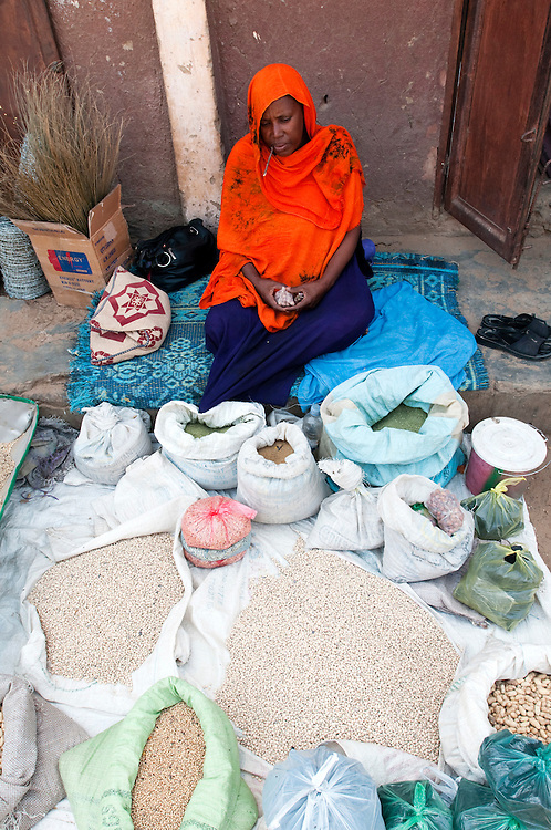 A woman selling locally grown grains and produce in the town market..Kankossa, Mauritania. 08/03/2011..Photo © J.B. Russell