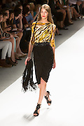 Dress witha black wrap skirt and animal print three-quarter sleeve boat-neck top n yellow, cream and black animal print. By Carlos Miele at the Spring 2013 Mercedes-Benz Fashion Week in New York.