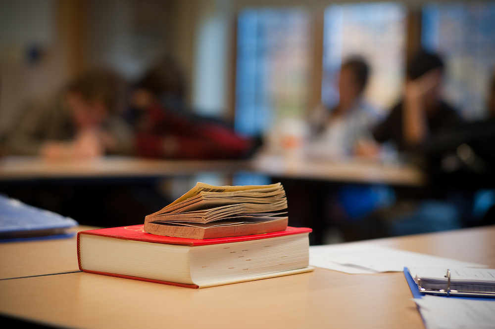books on table in school classroom
