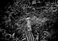 Entry into Pa Tik I Penan settlement on the edge of the Borneo rainforest where Penan live temporarily so that they can earn wages working in the region center of Bario.  Sarawak, Malaysia.