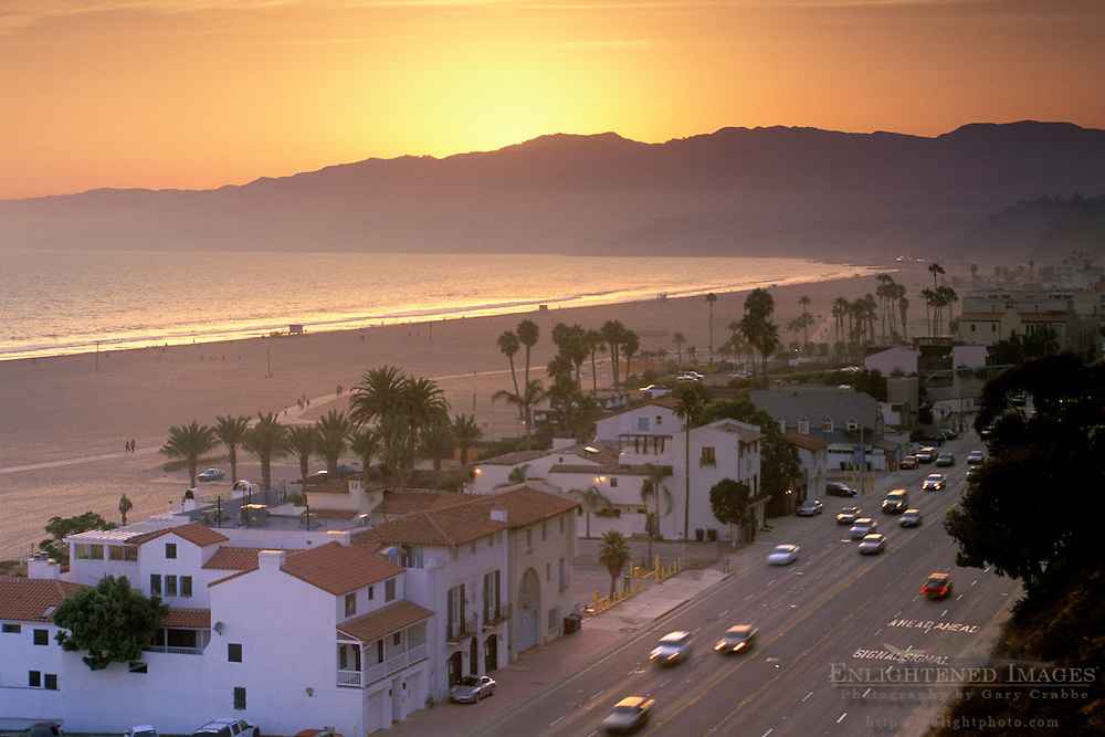 Sunset over the Pacific Coast Highway sand beach and mountains, Santa Monica, California Sunset over PCH Pacific Coast Highway road and mountains along sand beach at Santa Monica, Los Angeles, California