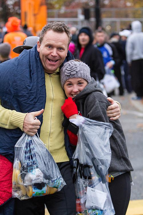 ING New York CIty Marathon: start line village, runners stay warm