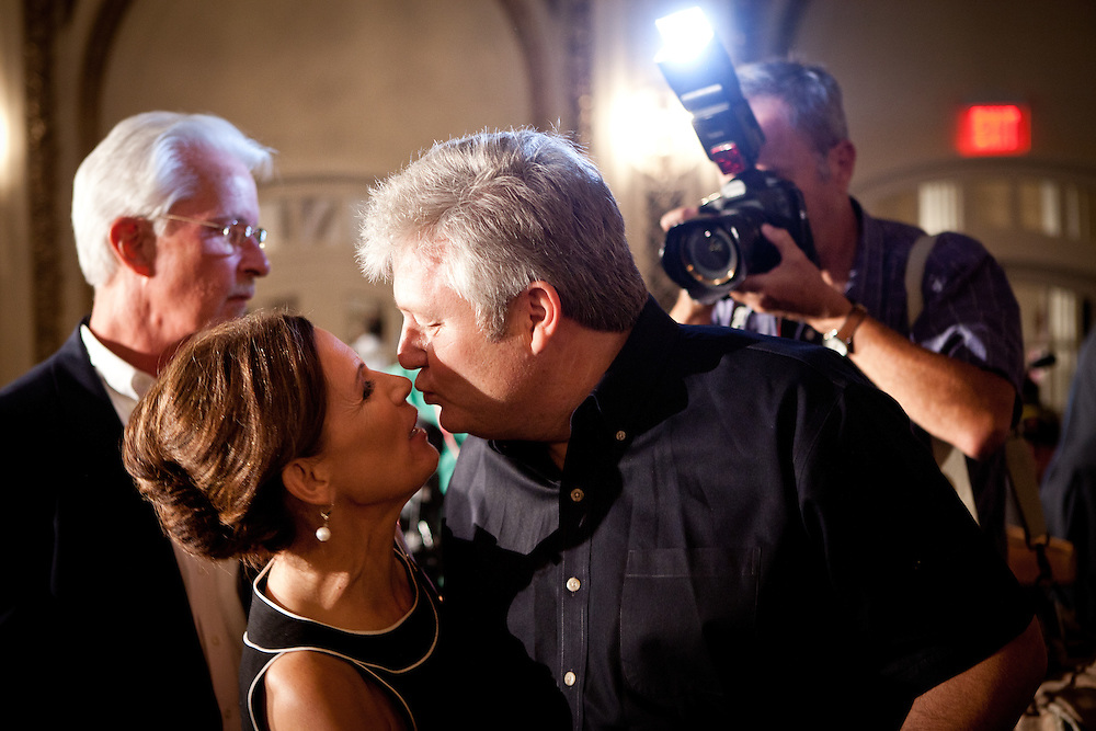 GOP Presidential candidate Rep. Michele Bachmann, left, dances with her husband, Marcus, at a rally in Davenport, Iowa, July 24, 2011.