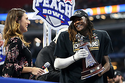 UCF Knights linebacker Shaquem Griffin (18) celebrates beating the Auburn Tigers during the 2018 Chick-fil-A Peach Bowl NCAA football game on Monday, January 1, 2018 in Atlanta. The UCF Knights beat the Auburn Tigers 34-27. (Jason Parkhurst / Abell Images for the Chick-fil-A Peach Bowl)