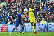 Burton Albion's Marvin Sordell and Cardiff City's Craig Bryson during the EFL Sky Bet Championship match between Cardiff City and Burton Albion at the Cardiff City Stadium, Cardiff, Wales on 30 March 2018. Picture by John Potts.