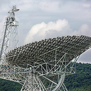 August 10, 2015, Green Bank, West Virginia: The Green Bank Telescope is seen from the National Radio Astronomy Observatory which operates the world premiere astronomical telescope operating from centimeter to millimeter wavelengths.   The telescope sits near the heart of the United States National Radio Quiet Zone, a large area where all radio transmissions are limited to avoid emissions toward the GBT and the Sugar Grove Research Facility, West Virginia. The existence of the telescope within the Radio Quiet Zone allows for the detection of faint radio-frequency signals which otherwise would be eclipsed by man-made signals. The observatory borders the National Forest and is shielded from radio interference by the Allegheny Mountains. Photo by Evelyn Hockstein