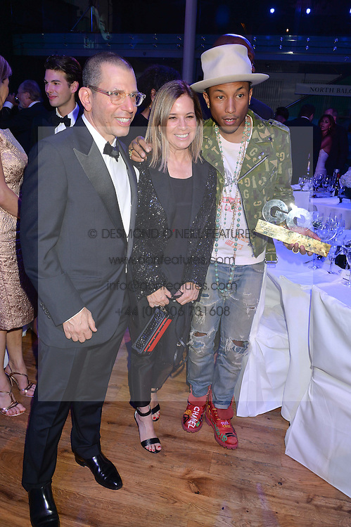 Left to right, JONATHAN NEWHOUSE, RONNIE NEWHOUSE and PHARRELL WILLIAMS at the GQ Men Of The Year 2014 Awards in association with Hugo Boss held at The Royal Opera House, London on 2nd September 2014.
