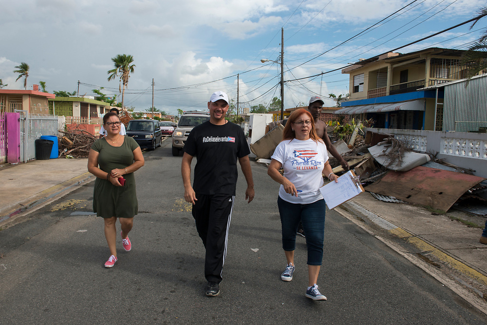 Toa Baja, PR, November 10, 2017--Moriama Cortés, Jesús Pagán Torres and Inamay Carreras are part of a team of faculty and staff of Escuela Delia Cabán who continue to distribute water and emergency relief in Tao Baja, PR neighborhoods still without power and water 50 days after Hurricane Maria.  Escuela Delia Cabán has served as a distribution point for the Puerto Rico Recovery Fund's emergency relief efforts since it was established days after the storm hit September 20, 2017.  Photo by Lori Waselchuk/BRAF