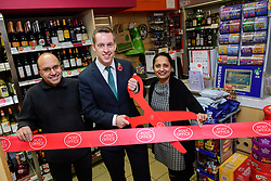 Pictured is Tom Pursglove MP, centre, cutting the ribbon to officially open Weldon Post Office.  Also pictured is Biren Tailor, left, and Devyani Tailor from Weldon Post Office.<br /> <br /> Tom Pursglove MP has officially opened the new Post Office at the Weldon Supermarket in Weldon.<br /> <br /> Date: November 10, 2017